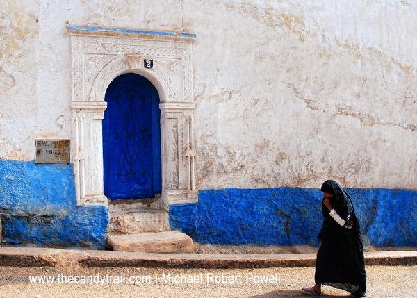 woman passing doorway