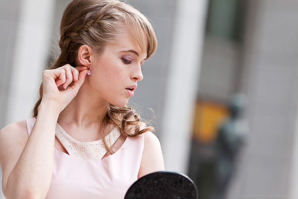 Woman trying on an earring