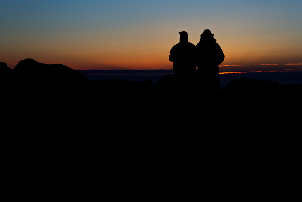 I was shooting the sunrise on Cadillac Mountain in Acadia National Park when I spied this couple sitting on a rock.  I moved around behind them, and spot-metered on the sky. Because the meter tries to make the metered area a mid-tone, I knew it would silhouette my subjects perfectly.