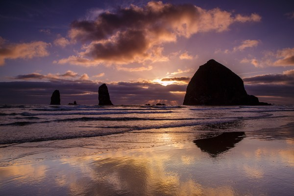 Haystack Rock dominates the landscape at Cannon Beach. The wet sand, dramatic skies, and great light combined for some great images. Canon EOS 5D Mark III, EF 24-70 f/2.8L II at 24mm.  1/40 second at f/16, ISO 200.  I used a 4 stop graduated neutral density filter on the sky.