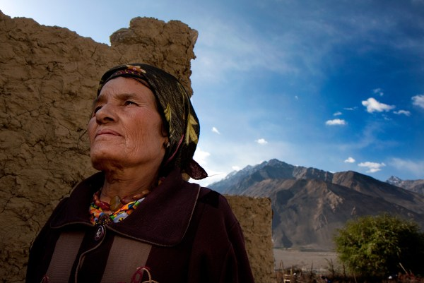 -Tajikistan- Canon EFS 17-55mm f/2.8 Fstop of 8, shutter speed@1\250and ISO 100 Natural light+ Reflector (gold color) I held in my hand on the lower left side of the frame + warm natural light bouncing off the mud wall