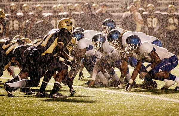 high school football in the rain