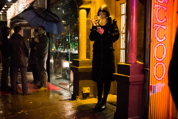 when to use a high ISO woman smoking at night