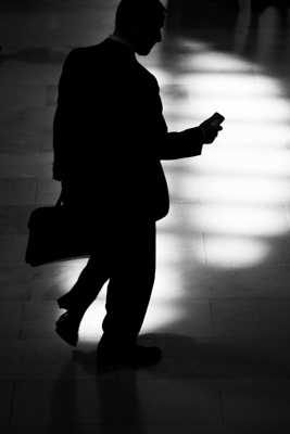 when to use a high ISO shadowy man with briefcase