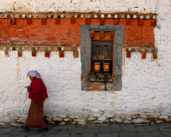 Everyday-Life-Woman-Spinning-Prayer-Wheels-at-7th-Century-Monastery-Bumthang-Bhutan-Copyright-2013-Ralph-Velasco.jpg