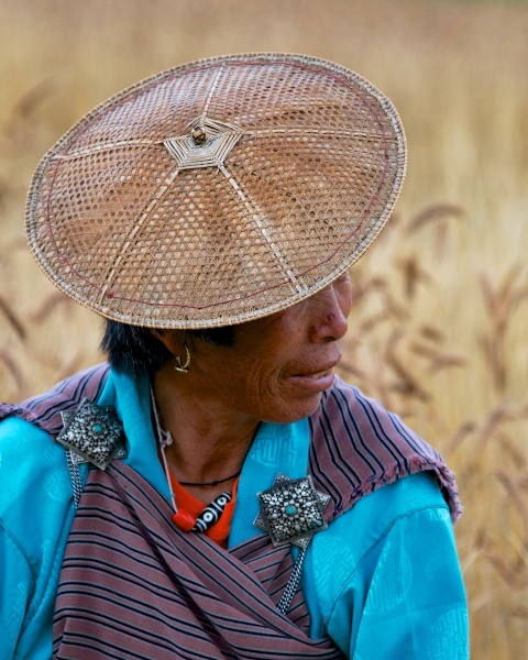 Travel Photography Tips - Native Clothing - Woman in Kira in Wheat Field  P  Bumthang Valley Bhutan  Copyright 2013 Ralph Velasco