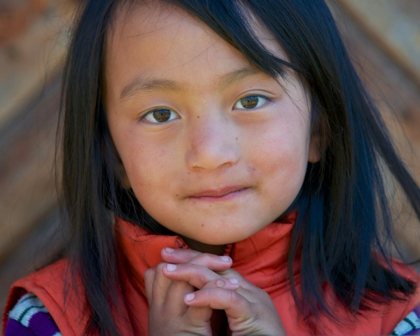 Travel Photography Tips - People - Little Girl with Hands Folded at Pepper House  Bumthang Valley Bhutan  Copyright 2013 Ralph Velasco