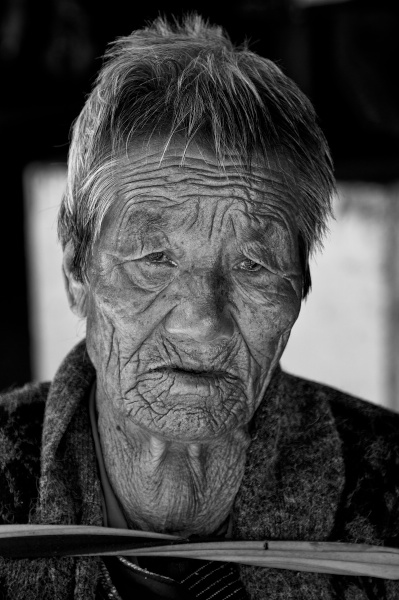 Travel Photography Tips - People -  Time in a Face  Thimpu Bhutan  Copyright 2013 Ralph Velasco