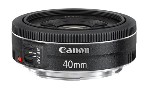 The Canon 40mm f2.8 pancake is about as small and light as you can get. Pancake lenses are the ultimate in unobtrusive lenses.