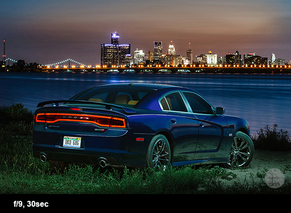 Dodge Charger with the skyline of Detroit City