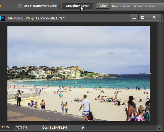 Click Straighten Layer in Photoshop CS5 and later to straighten using the Ruler tool.