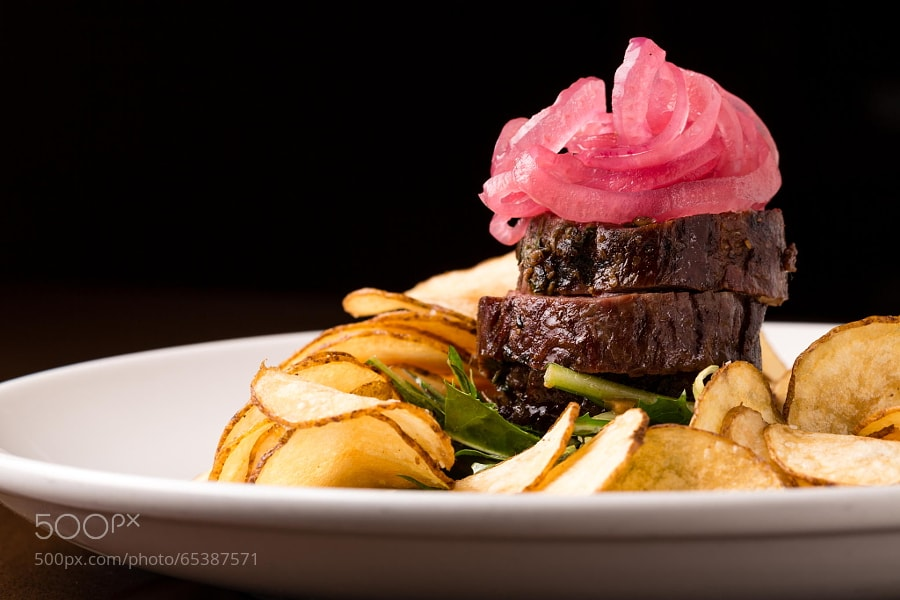 Photograph Skirt Steak Topped with Pickled Red Onions by Bradford Tennyson on 500px