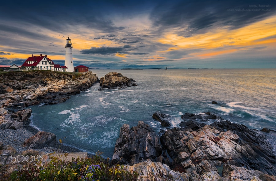 Photograph Sunset at Portland Head Light by Noppawat Charoensinphon on 500px
