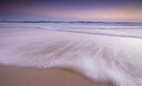 A somewhat abstract seascape scene, the movement of the water makes the image dramatic