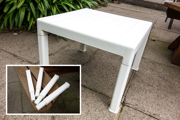 Small white plastic garden table