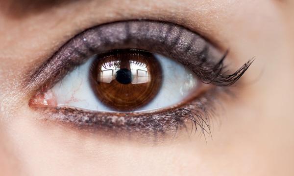 An eye lit by windows