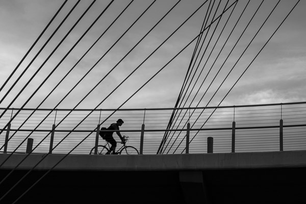 I must admit, I had an ulterior motive when I suggested that we go for an evening walk over a bridge, down next to a highway so I could get this shot... ©Valérie Jardin