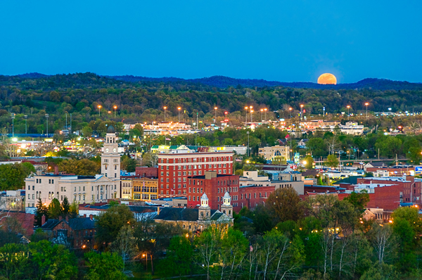 """Here the April moon called the """"Pink Moon"""" rose over Marietta, Ohio. The setting sun lit the city in a warm glow."""