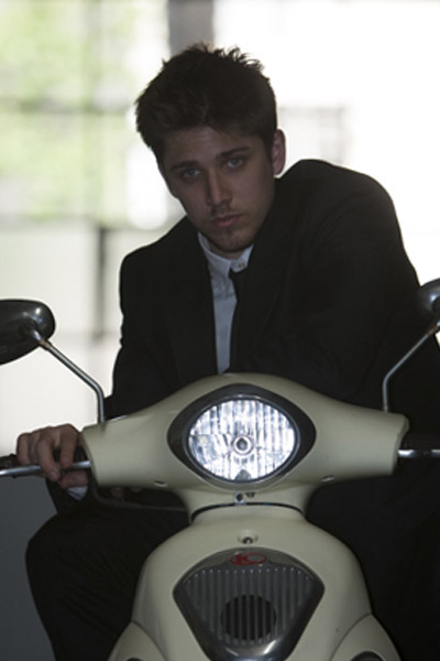 on-camera flash photo of man on a motorcycle