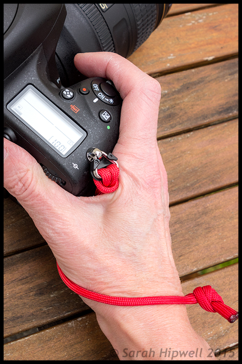 Paracord-wrist-strap-on-hand
