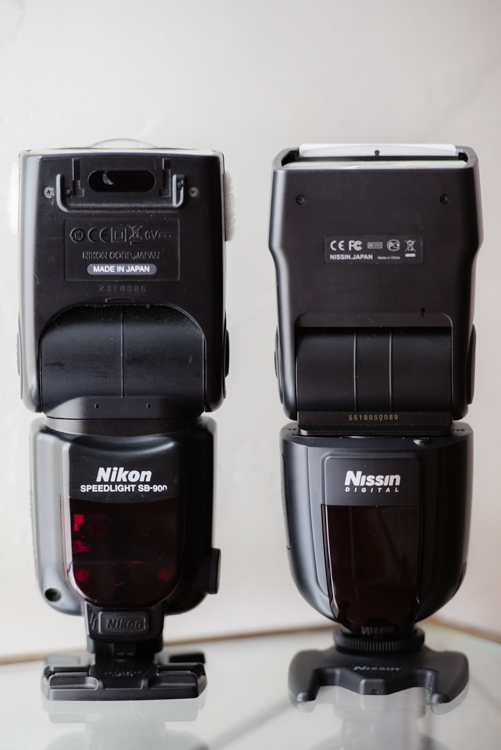 Side by side comparison of the Nissin Di700A and the Nikon SB-900