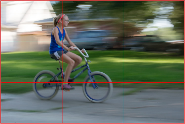 motion-and-composition-bike-left-panning-grid