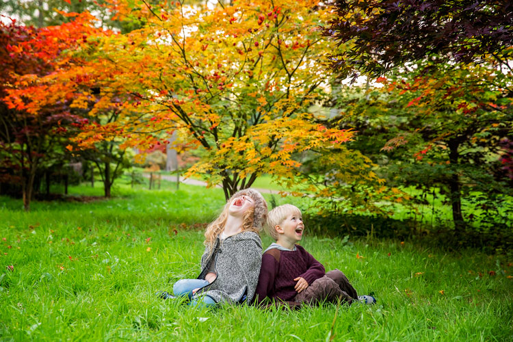 kids laughing hysterically during photo shoot