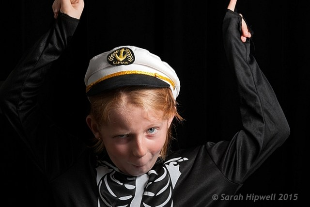 Young girl low key photography in Halloween costume
