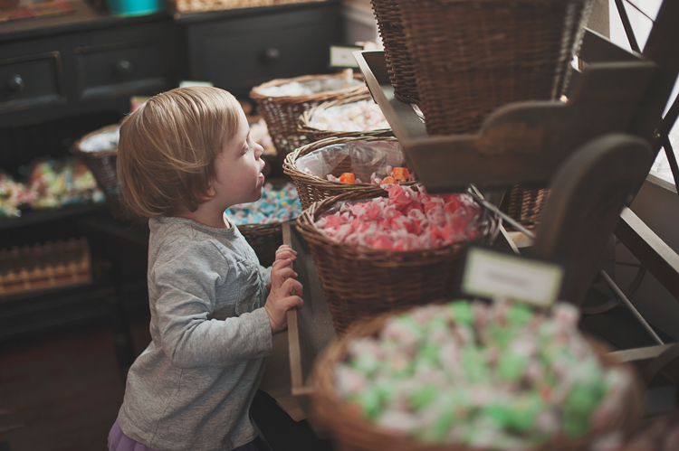 child looking in candy baskets