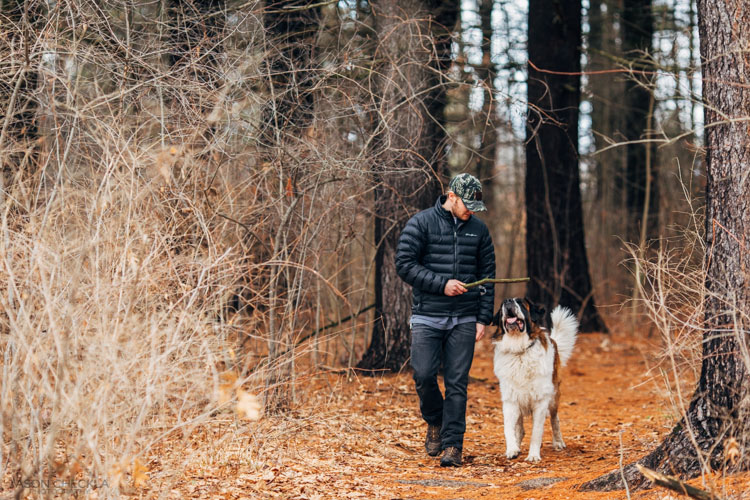 man with dog in the forest