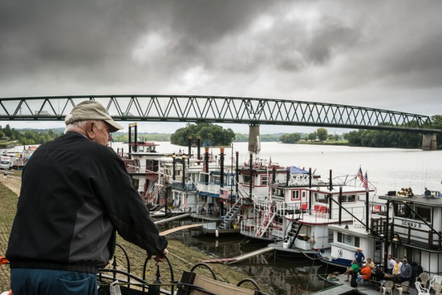 This image seems to tell the story of a man thinking about the yester-years working on a river boat.