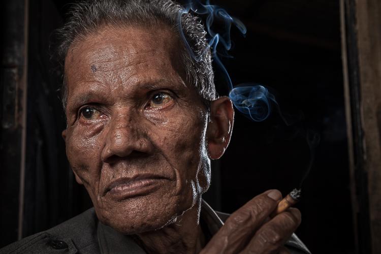 portrait of a man smoking a cigarette