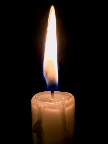 Focussing and exposing on the candle has made the background go very dark. This works well to isolate the subject more.