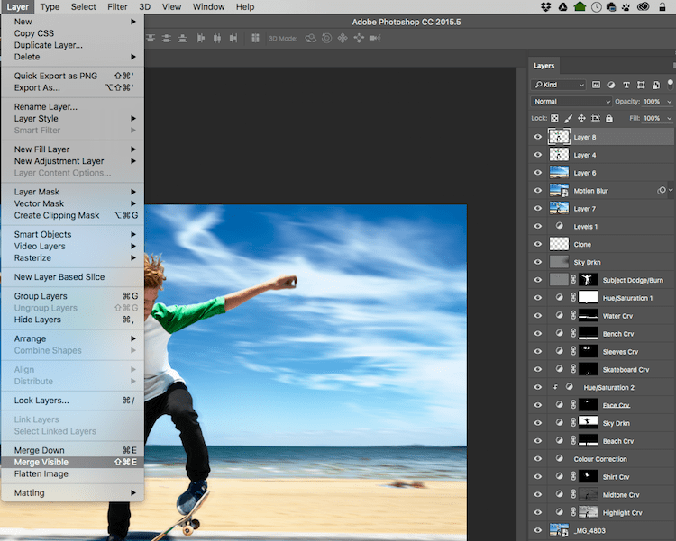 With the top visible layer selected, go Layer > Merge Visible.