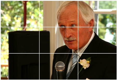 man with microphone following the rule of thirds