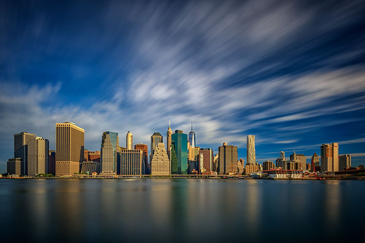 Using filters - a 10-stop ND filter to achieve a slower shutter speed of 60 seconds, I was able to capture the motion of the clouds as they passed over New York City.