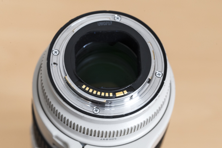 With this lens the rear elements sits deeper in the lens barrel.