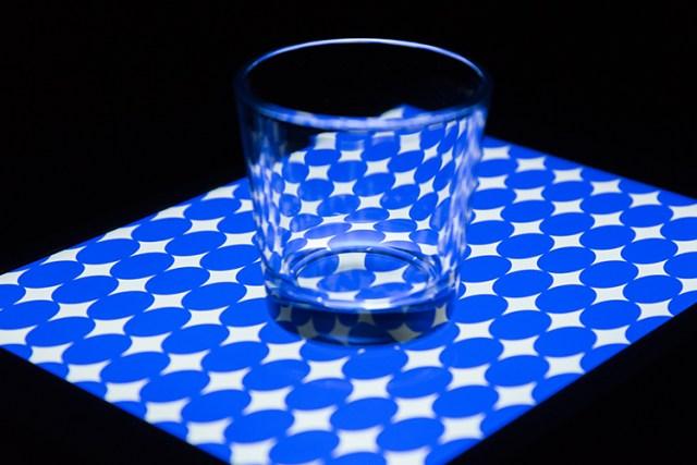 glass-tumbler-on-blue-circles-background