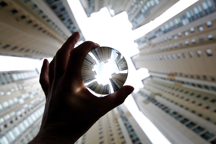 Apartment buildings in Busan, South Korea. This photo shows a glass ball being held by hand.