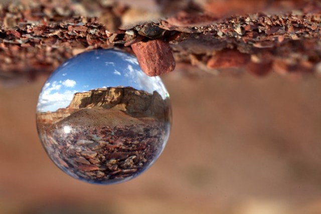 Deserts and canyons make for great locations to photograph with the ball. In this photo the ball is place on the ground, the stones in the foreground add a nice element to this photo.