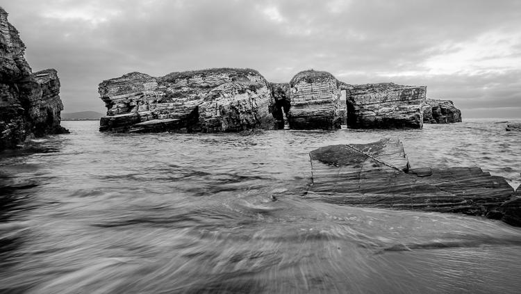 relatively short seaside rock exposure