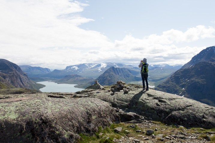 A man on a mountain, taking a photograph