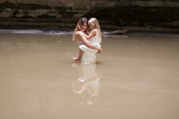 Reflections of people in water image - 15 Photography Exercises to Boost Your Creativity