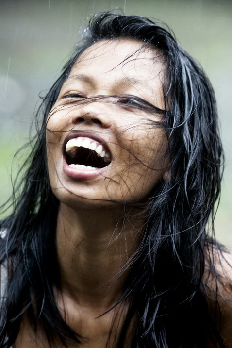 Image: Slightly blurred laughing girl.