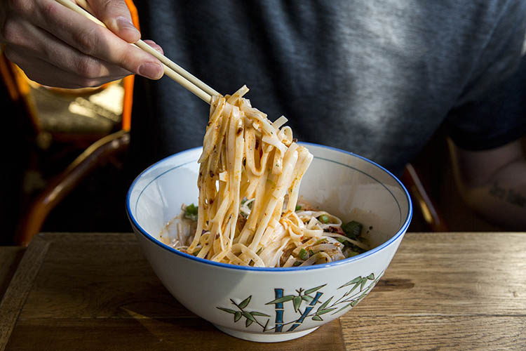 6 Tips for Improving Your Food Photography Instagram Game - noodles and hand