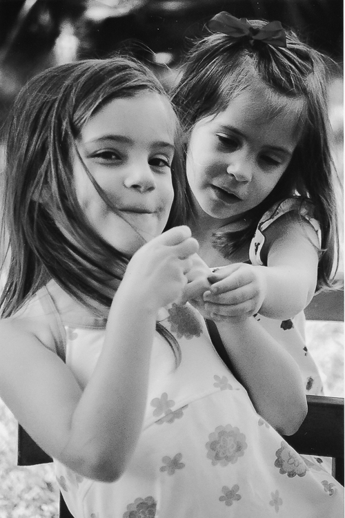 B&W photo of two little girls illustrates letting go of perfection in photography