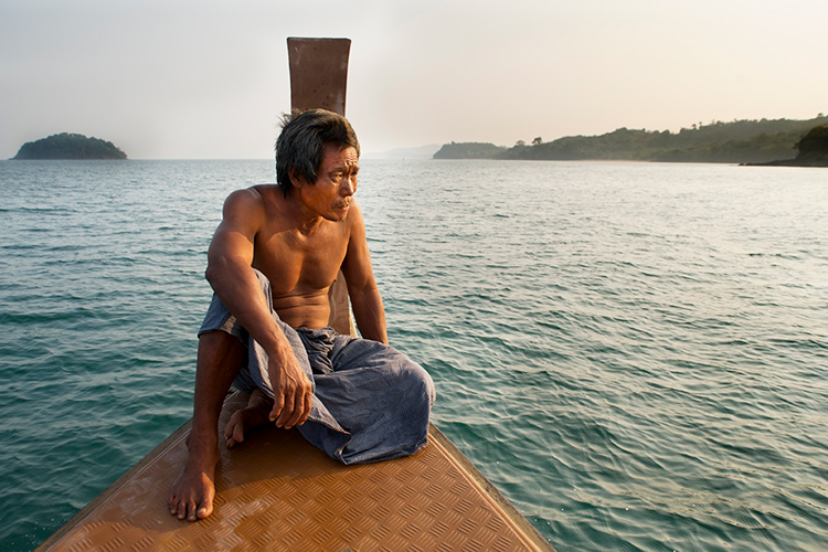Sea gypsy sitting on the bow of his boat - 5 Key Elements that Directly Impact the Quality of Your Photography