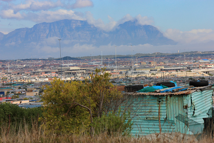 Letting go of perfectionism in photography. Photo shows Khyelitsha township in South Africa, with Table Mountain in the background.