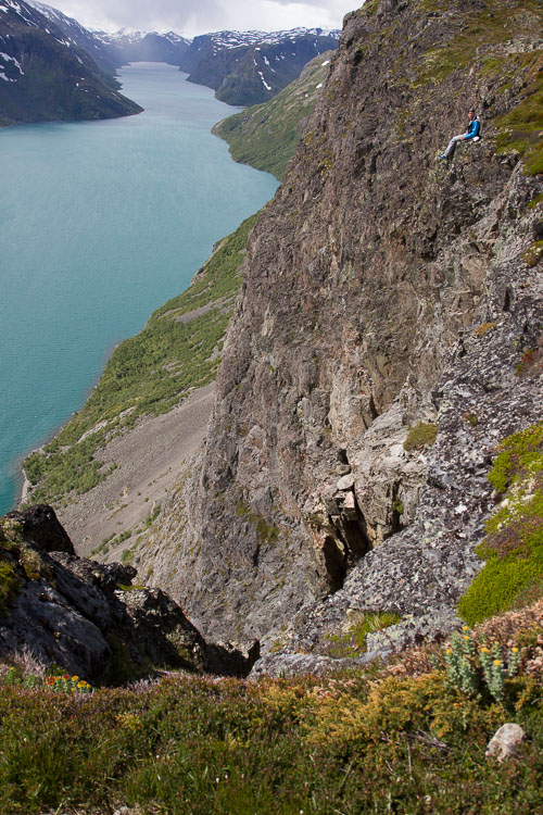 A hiker in the mountains, photographed to show the scale of the cliffs - How to Show a Sense of Scale in Your Photography