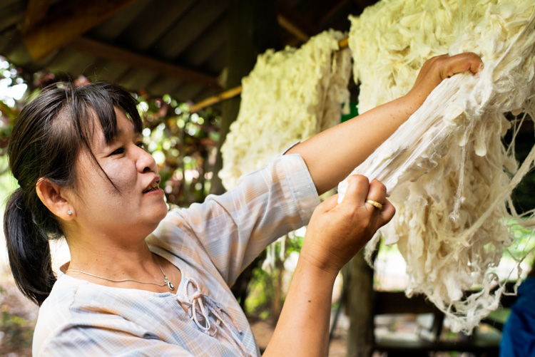 A woman prepares raw silk before she spins it in north Thailand. Why Volunteering is a Great Way to Grow as a Photographer